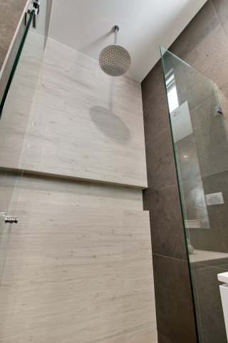 Rounded rainfall shower head