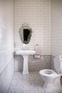 White eclectic style bathroom renovated with modern lines and curves.