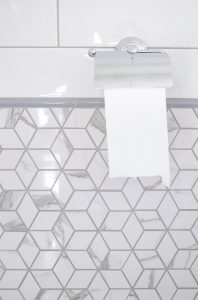 Renovated and redesigned with marble diamond mosaics and staggered gloss white subway tiles
