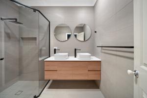 Wall hung vanity next to corner shower