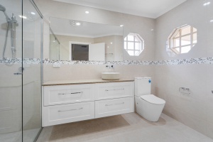 Wide Vanity for great storage. Warm toned bathroom