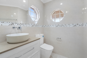 Soft Whites and Warm Stone create a homely feel in this bathroom